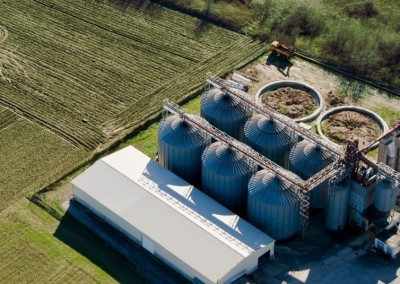 Tower silos and storage facility, aerial view